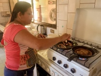 Gisele cooking breakfast